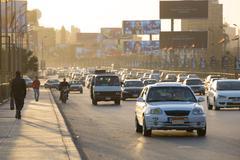 Cairo traffic at dusk - stock photo