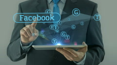 Business man pointing on facebook social network media concept tablet pad Stock Footage