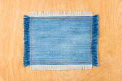 Frame for the text from a blue jeans fabric with the stitched lines of an ora Stock Photos