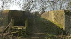 4K Bridge Walkway Public Footpath Over Train Tracks Countryside Trees Woodland Stock Footage