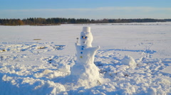 The blue eyed snowman holding a stick Stock Footage