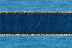 Fashionable background,  jeans and yellow  rhinestones - stock photo