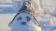 The chubby snowman with a bonnet - stock footage