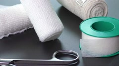 Medical bandages with scissors and sticking plaster Stock Footage