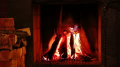 Fire in the Fireplace and Basket of Firewood. Real Audio - stock footage