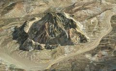 Isolated rock mountain from aerial view - stock illustration
