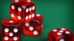 Red dice on a green felt Stock Photos