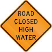 Road sign used in the US state of Virginia - Road closed high water - stock illustration