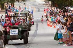 Korean War Veteran Waves During Old Soldiers Day Parade - stock photo