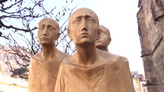 Three men wooden figures outside the Cathedral of Bolzano-Bozen - wood carving Stock Footage