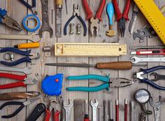 Tools on a wooden floor, top view. - stock photo