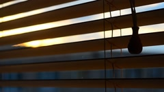 Looking Through the Wood Window Blinds. Sunlight through blinds Stock Footage
