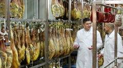Two factory labours controlling wurst Stock Footage