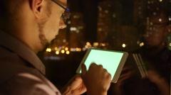 Men scrolls browser on tablet Stock Footage