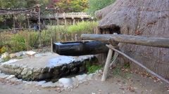 Water powered tilt hammer mill in the Minsok Korean Folk Village. Stock Footage