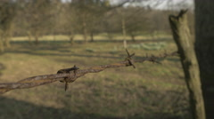 4k Close Up Rusty Barbed Wire Wooden Post Field Countryside Hand Held Stock Footage