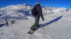Snowboarding in Val d´isere on a sunny day Stock Footage
