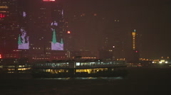 Ferry cruises in Victoria Harbor  at night Stock Footage
