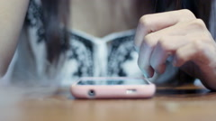 Soft focused young girl browsing smartphone while smoke spreading Stock Footage