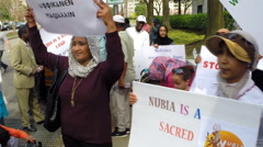 Nubians protest against proposed hydroelectric dams. - stock footage