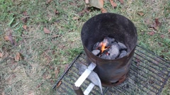 Extinguishing Coal In A Chimney Starter Stock Footage