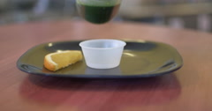 Wheatgrass Pour In a Juice Bar Stock Footage