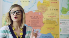 Stock Video Footage of Teacher standing next to the map and teaching geography