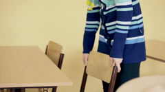 Teacher cleaning class during the break, steadycam shot Stock Footage