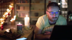Man lying in his christmassy room and doing serious look to the camera - stock footage