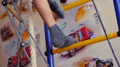 Child is engaged in a sports training apparatus at home in slowmotion. 1920x1080 Stock Footage