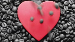 Coffee grains fill up heart. Stock Footage