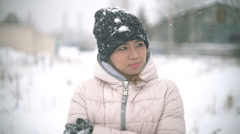 Asian Girl shivering from the cold in winter during snowfall slowmotion Stock Footage
