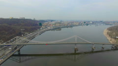 Quadrocopters flying over the bridge across the river in Kiev Stock Footage