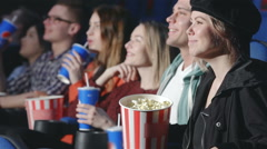 Perspective view of seven people in the cinema - stock footage
