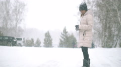 Young Woman during heavy snowfall 4k UHD (3840x2160) Stock Footage