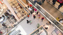 Slightly panned up high shot of people shopping - stock footage