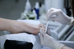 Close-up of the process pedicure in salon - stock photo