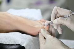 Pedicure process. cuticle - stock photo