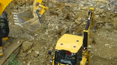 Hydraulic hammer breaker on excavator destroying rocks at building foundation Stock Footage