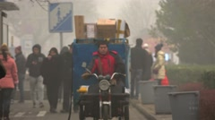 Beijing in dense smog. Cargo motorbike & locals on the Jingshan Front street Stock Footage