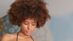 Stock Video Footage of Attractive African American ethnic woman portrait indoors