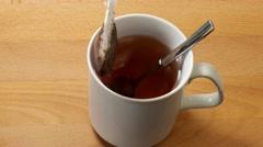 Preparing tea with tea bag Stock Footage