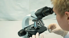 Female doctor scientist looking through microscope Stock Footage