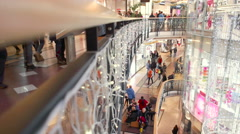 Side view of shopping mall floors full of people Stock Footage
