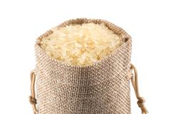 Long grain rice on white background Stock Photos