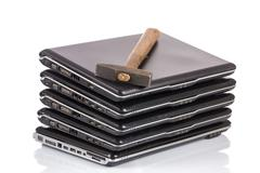 stack of old laptops awaiting repair - stock photo