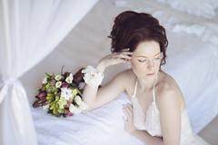 Beautiful sexy lady in elegant white panties and bra Stock Photos