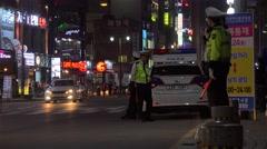 Police services at Gwanganhaebyeon road (Gwangalli Beach) at night. Busan Stock Footage