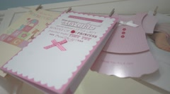 Display of baby girl cards, tracking shot Stock Footage