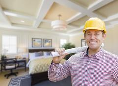 Contractor in Hard Hat Over Custom Bedroom Drawing and Photo Stock Photos